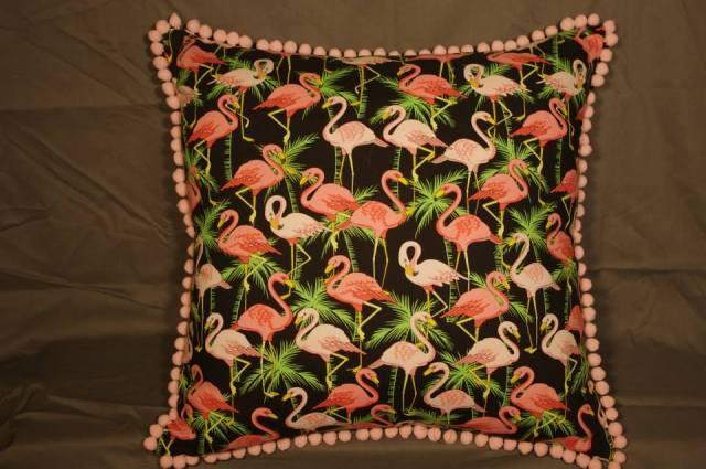 Retro flamino print cushion on black with your choice of pom pom trim